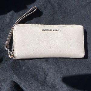 Micheal Kors Gray zip around clutch wallet